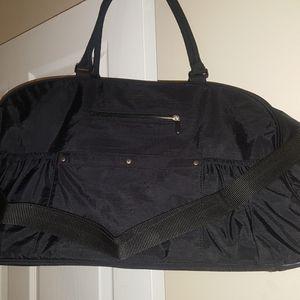 Black nylon traveling bag